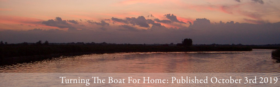 turning the boat for home norfolk broads landscape banner image